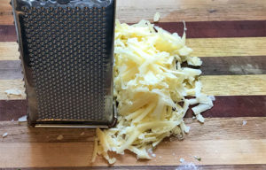 Grate a cup or more of a flavorful cheese.